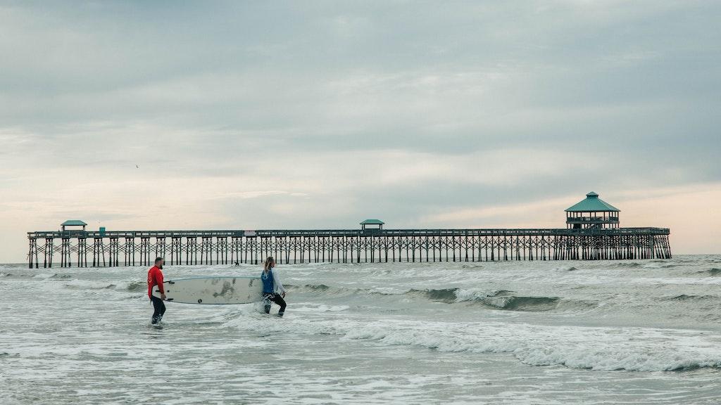 Surfers on Folly Beach