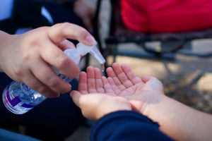 Child using hand sanitizer